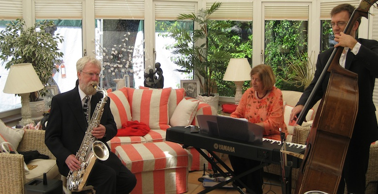 The Abbey Jazz Trio playing in a conservatory at a garden party