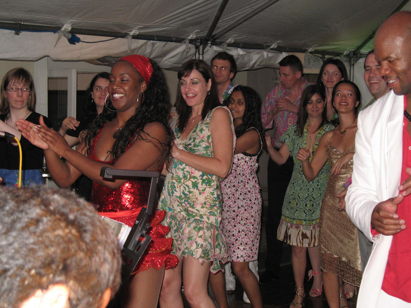 Amanda Demerara, our salsa dancer, demonstrating to guests at a birthday party in Little Venice