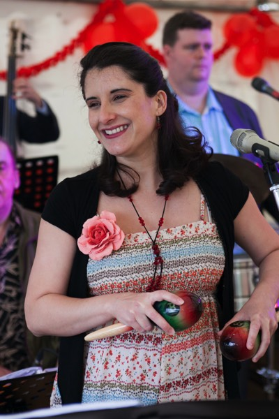 Cuban singer Dunia playing maracas at a birthday party in Wiltshire