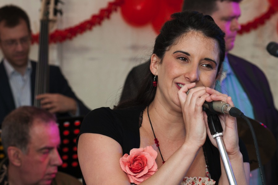 Cuban singer Dunia Correa fronting live latin band Jan y su Salsa at a birthday party in Wiltshire