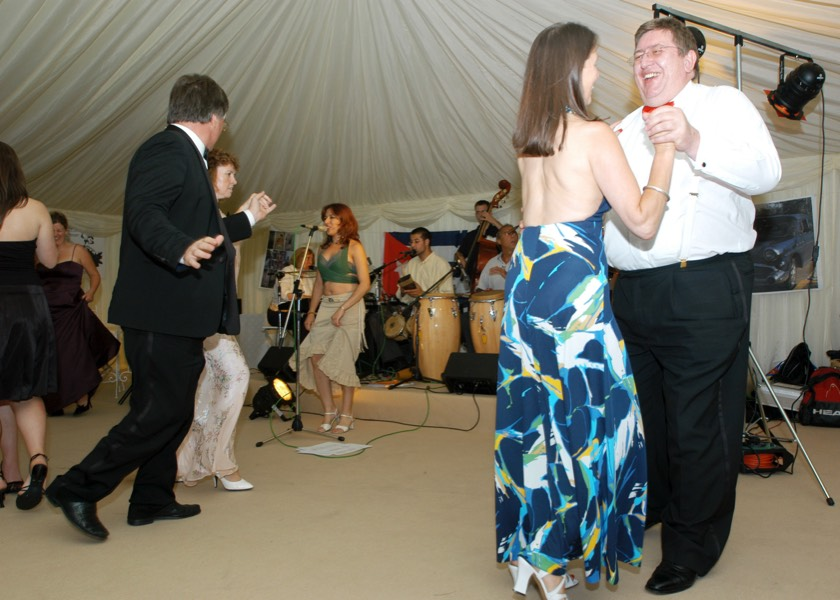 Guests dancing to live latin band Jan y su Salsa at a corporate party in Gloucestershire. Fronted by singer Taide