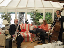 The Abbey Jazz Trio (saxophone, piano and double bass), performing at a birthday party in a conservatory