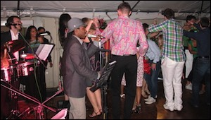 Jan y su Salsa Latin Band performing at a party in Little Venice, London with Cuban singer Enrique